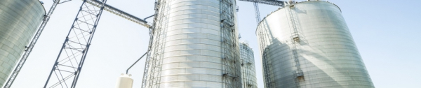 Huge, silver, shiny agricultural silos.